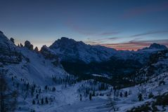 Ethereal sunset in snowy mountain valley Royalty Free Stock Image
