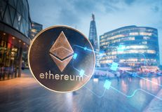 ethereum against skyscrapers - futuristic smart city - cryptocurrency concept royalty free stock photography