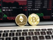 Ethereum and Bitcoin Emblems Royalty Free Stock Photography