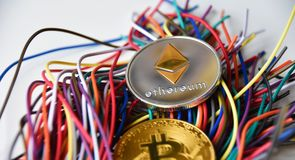 Ethereum and Bitcoin and wires royalty free stock photo
