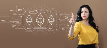 Ethereum with business woman. On a brown background stock photography