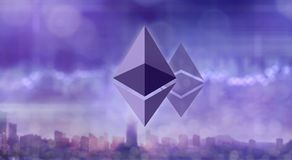 Ethereum and Ethereum classic icons on the blurred ultraviolet background of a modern city Stock Image