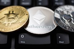 Ethereum coin with bitcoin and ripple Royalty Free Stock Image
