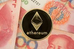 Ethereum coin on chinese yuan bills - crypto currency in china concept. Real Ethereum coin on chinese yuan bills - crypto currency in china concept stock image