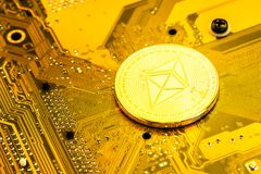 Ethereum coin on circuit board royalty free stock photography