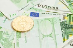Ethereum coin on euro money stock photos
