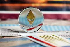 Ethereum coin on diagrams Royalty Free Stock Images