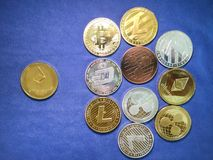 Ethereum coin and others crypto coin on blue cloth. Virtual cryp Royalty Free Stock Images