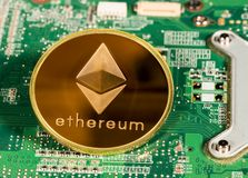 Ethereum coin on a printed circuit board Royalty Free Stock Image