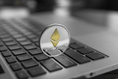 Ethereum coin symbol on laptop, future concept financial currency, crypto currency sign. Blockchain mining. Digital. Money and virtual cryptocurrency concept stock photography