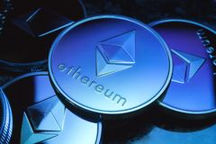Ethereum coins with blue tint royalty free stock photo