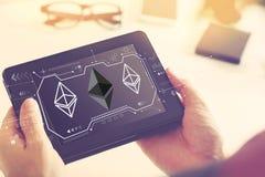 Ethereum com um tablet pc fotografia de stock