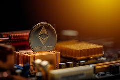 Ethereum crypto currency. On a computer motherboard stock photography