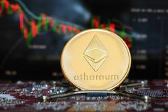 Ethereum. Crypto currency. Ethereum golden coin on the computer board and a chart on background. Blockchain technology royalty free stock photos