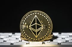 Ethereum crypto-currency on keyboard. With black background royalty free stock photography