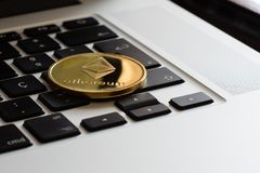 Ethereum cryptocurrency coin over a keyboard royalty free stock photography