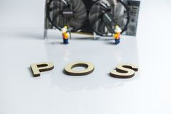 Ethereum Cryptocurrency switching from POW, GPU mining to POS, POS sign with graphic card and figures in the background. Ethereum Cryptocurrency switching from stock photography