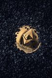 Ethereum gold coin. On a black background stock images