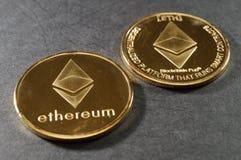 Ethereum golden coins. Physical cryptocoins Stock Photos