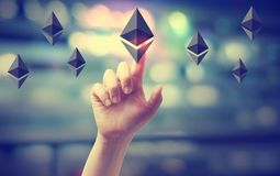 Ethereum with hand pressing a button. On blurred abstract background stock image