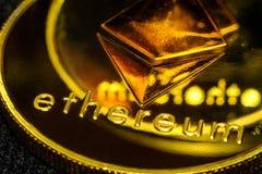 Ethereum macro symbol sign close-up golden. Coins Stock Photos