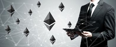 Ethereum with man holding tablet computer. Ethereum with man holding a tablet computer Stock Images
