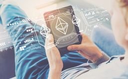 Ethereum with man using a tablet stock images