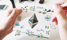 Ethereum met bemant handen en notitieboekje Royalty-vrije Stock Foto's