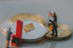 Ethereum miners figures working stock images