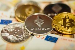 Ethereum moneta z innym cryptocurrency na euro notatkach zdjęcie stock