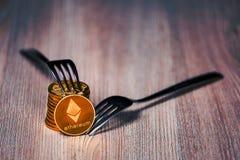 Ethereum mynt på en trätabell royaltyfri foto