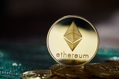 Ethereum on the pile of cryptocurrency on wooden table as most important cryptocurrency concept. Ethereum on the pile of cryptocurrency over wooden table as stock images
