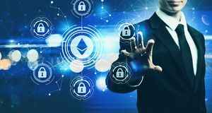 Ethereum security theme with businessman on blue light background. Ethereum security theme with businessman on blurred blue light background Royalty Free Stock Photos
