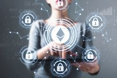 Ethereum security theme with woman using a tablet royalty free stock photos