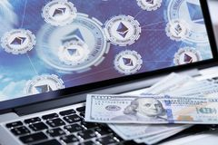 Ethereum symbol on laptop screen with money Royalty Free Stock Photos