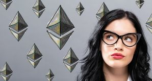 Ethereum with young businesswoman. In a thoughtful face Royalty Free Stock Photos