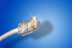 Ethernet cable. In a blue background Royalty Free Stock Photos