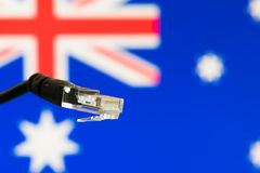 Ethernet cable with Australian  flag in the background. Symbolizing internet in Australia Stock Image