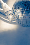 Ethernet cable for computer and globe Stock Image
