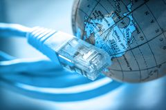 Ethernet cable and globe royalty free stock photos