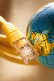 Ethernet cable and globe Stock Photos