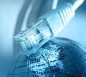 Ethernet cable and globe Royalty Free Stock Images