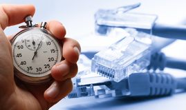 Ethernet cable and stopwatch Royalty Free Stock Photo