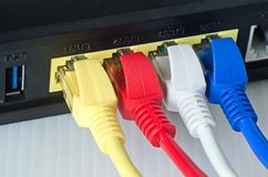 Ethernet cables connect to router or switch.  Stock Images