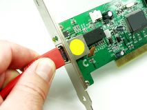 Ethernet card. Network Cable pluged into ethernet card Royalty Free Stock Image