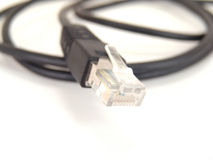 Ethernet cord and router Stock Photography