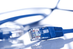 Ethernet LAN cable. Blue ethernet local area network cable reflecting on white background Royalty Free Stock Image