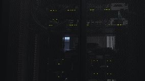 Ethernet Network Connection Hub. Blinking lights in a dark server room, Close-up view of Ethernet cables wired to router 4K. Ethernet Network Connection Hub stock video footage