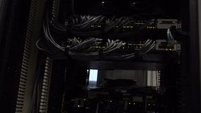 Ethernet Network Connection Hub. Blinking lights in a dark server room, Close-up view of Ethernet cables wired to router 4K. Ethernet Network Connection Hub stock footage