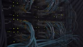 Ethernet Network Connection Hub. Blinking lights in a dark server room, Close-up view of Ethernet cables wired to router 4K.  stock footage